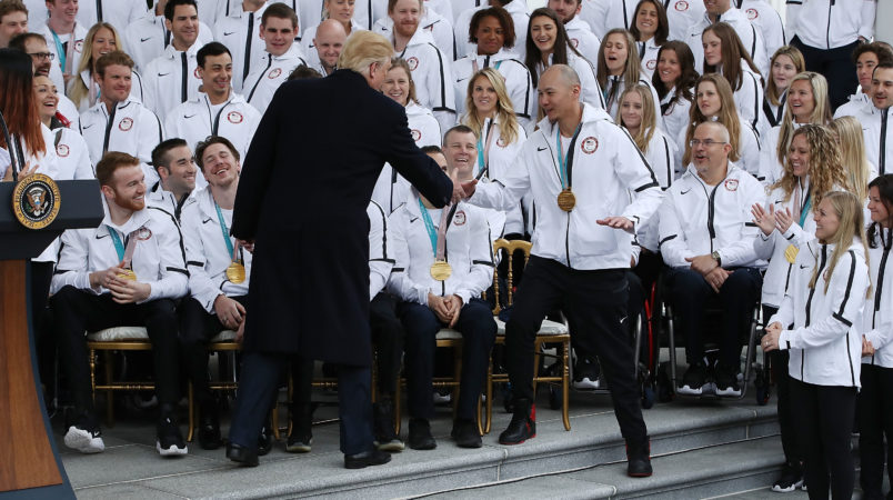 President Donald Trump applauds Olympians during White House visit