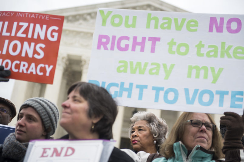 UNITED STATES - JANUARY 10: Rep. Joyce Beatty, D-Ohio, second from right, is seen during a rally outside the Supreme Court on January 10, 2018, to oppose Ohio's voter purging system. The court heard arguments on whether Ohio has been too strict in setting in motion a voter registration removal process if the individual haven't voted in a federal election for two years. (Photo By Tom Williams/CQ Roll Call)