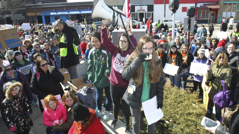 Meredith Gallagher, 15, of Cuyahoga Falls, the organizer of the Akron March for Our Lives event to end gun violence, yells into the microphone as she leads a rally at Highland Square in Akron, Ohio, on Saturday, March 24, 2018. (Karen Schiely/Akron Beacon Journal/TNS)