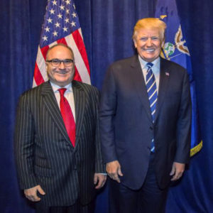 **HOLD FOR STORY TO MOVE OVERNIGHT. WDC WILL ADVISE TIMING** This photo acquired by The Associated Press is copied from a leaked email sent by Elliott Broidy and shows George Nader posing for a photo with President Donald Trump back stage at an RNC fund raiser in Dallas on Oct. 25, 2017. (AP Photo)