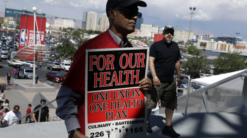 Culinary Union members file into a university arena to vote on whether to authorize a strike Tuesday, May 22, 2018, in Las Vegas. (AP Photo/Isaac Brekken)