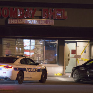 """Police stand outside the Bombay Bhel restaurant in Mississauga, Ont. on Friday May 25, 2018. Fifteen people were injured Thursday night when an explosion police say was caused by an """"improvised explosive device"""" ripped through a restaurant in Mississauga. Ontario. THE CANADIAN PRESS/Doug Ives"""