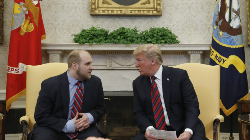 President Donald Trump, right, talks with Joshua Holt, who was recently released from a prison in Venezuela, in the Oval Office of the White House, Saturday, May 26, 2018, in Washington. (AP Photo/Alex Brandon)