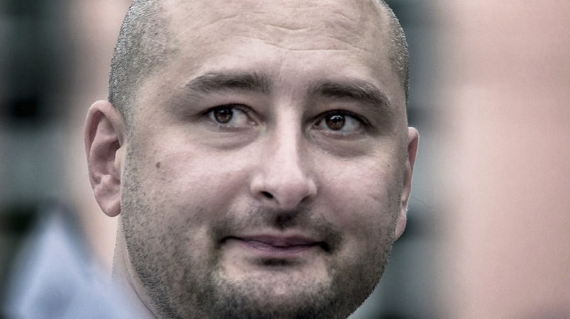 In this photo taken on Friday, Aug. 9, 2013, Arkady Babchenko, 41, who had been scathingly critical of the Kremlin in recent years, looks at an opposition picket in Moscow, Russia. Police in the capital of Ukraine say a Russian journalist has been shot and killed at his Kiev apartment. Ukrainian police said Arkady Babchenko's wife found him bleeding at the apartment on Tuesday and called an ambulance, but Babchenko died on the way to a hospital. (AP Photo/Alexander Baroshin)