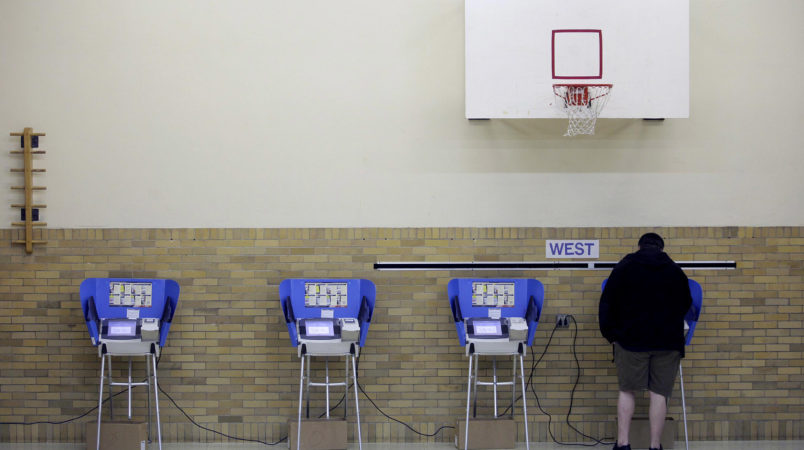 Bowling Green, OH  - NOVEMBER 6: A man casts his ballot using an electronic voting machine November 6, 2012 at an elementary school in Bowling Green, Ohio. Voting is underway in the US presidential election in the battleground state of Ohio. (Photo by J.D. Pooley/Getty Images)