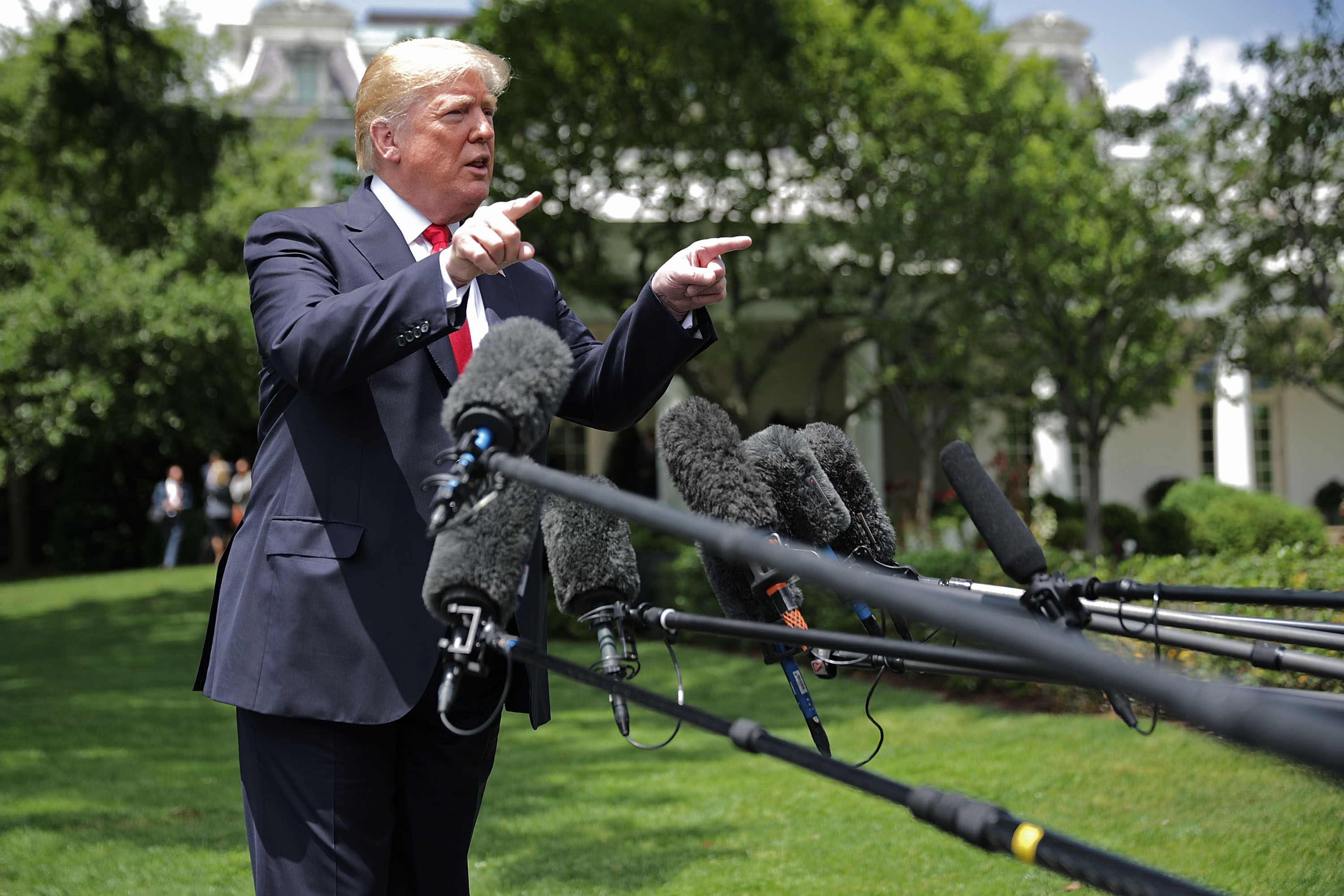 U.S. President Donald Trump talks to journalists before departing the White House May 23, 2018 in Washington, DC. Trump is traveling to New York where he will tour theÊMorrelly Homeland Security Center and then attend aÊroundtable discussion and dinner with supporters before returning to Washington.Ê