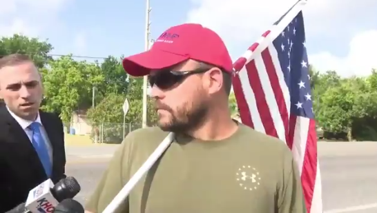 Man Sporting 'MAGA' Hat, Flag, And Pistol Appears At TX HS After Shooting