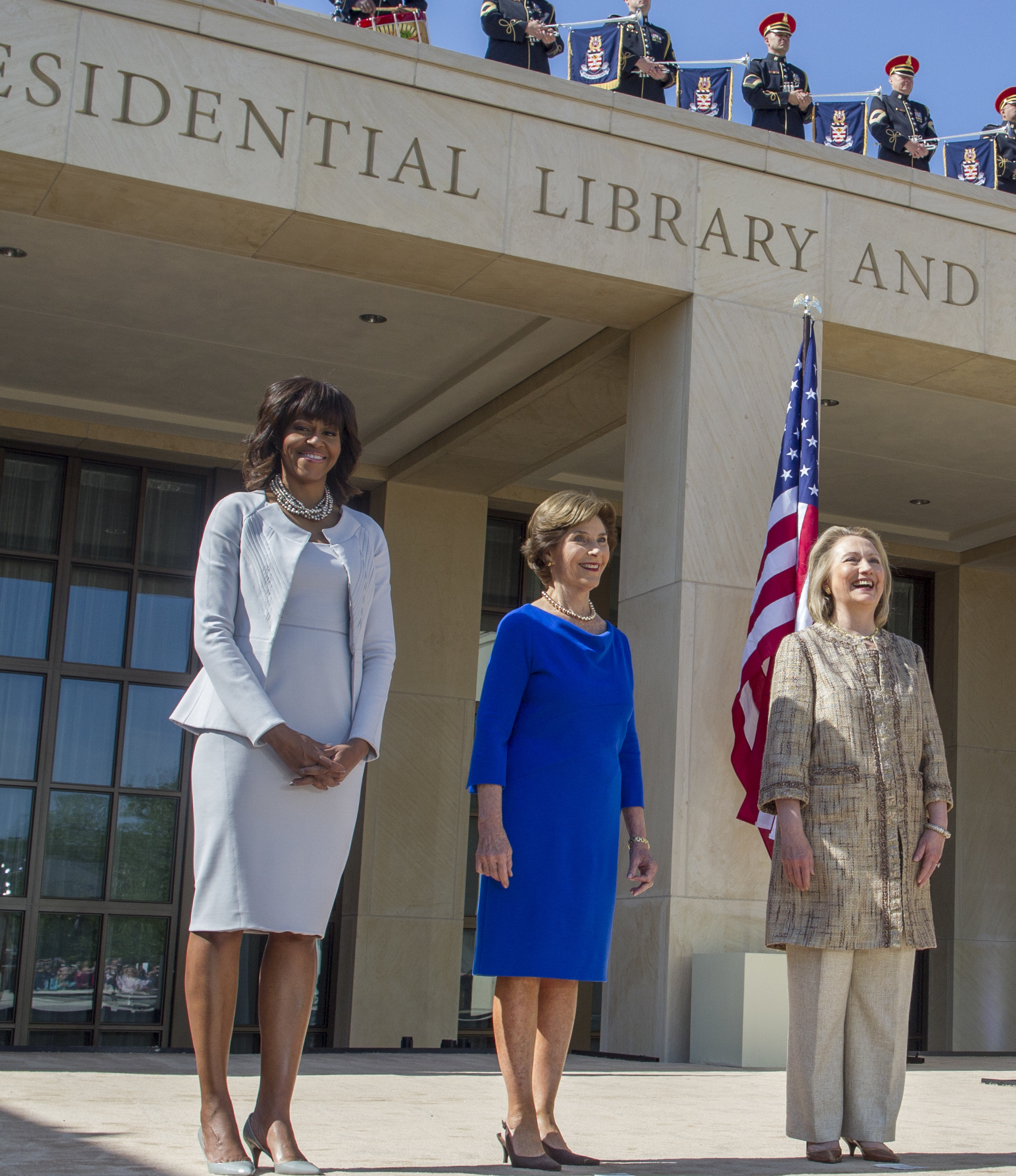 U.S. First Lady Michelle Obama (L) poses with former first ladies (2nd L-R) Laura Bush, Hillary Clinton, Barbara Bush and Rosalynn Carter as they attend the dedication ceremony for the George W. Bush Presidential Center in Dallas (Photo by Brooks Kraft LLC/Corbis via Getty Images)
