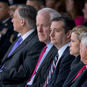 U.S. Senators John Cornyn, l, and Ted Cruz of Texas pause as dozens of Purple Hearts and two Defense of Freedom Medals were awarded at Fort Hood, Texas to victims and family of the 2009 terrorist attack.   Maj. Nadal Hasan is on death row for the attack that claimed 12 lives and wounded dozens.